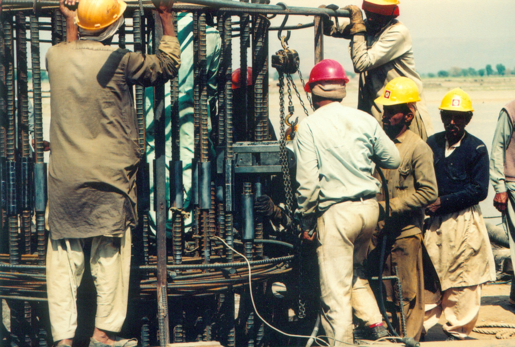 Lowering of Steel reinforcement cage for 2 meter diameter piles using couplers and crimping machines for bridge over River Jehlum at Bhera, Lahore-Islamabad Motorway